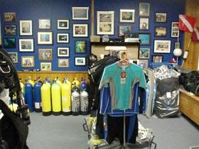 Photo of Ocean Horizons Scuba shop in Brooklyn. Shows scuba gear and oxygen tanks.